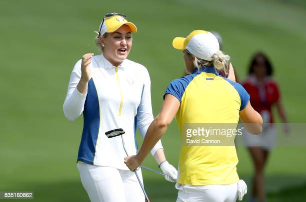 Charley Hull of England and the European Team celebrates holing a chip shot to win the hole on the 16th hole in her match with Melissa Reid against...