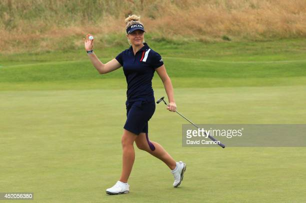 Charley Hull of England celebrates a birdie putt on the 18th green during the third round of the Ricoh Women's British Open at Royal Birkdale on July...