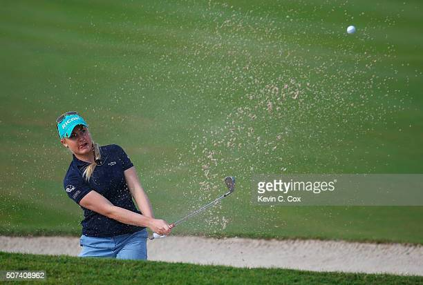 Charley Hull of England chips out of the sand on the seventh hole during the second round of the Pure Silk Bahamas LPGA Classic at the Ocean Club...