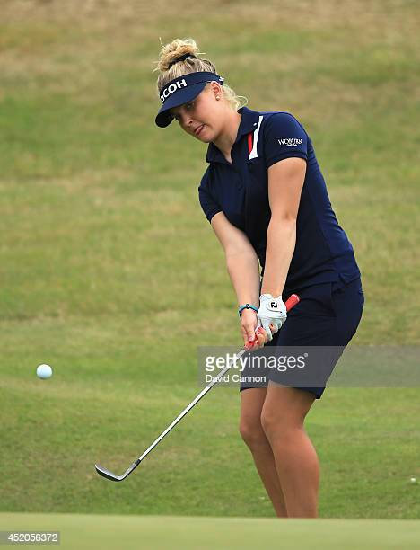 Charley Hull of England chips to the 18th green during the third round of the Ricoh Women's British Open at Royal Birkdale on July 12, 2014 in...