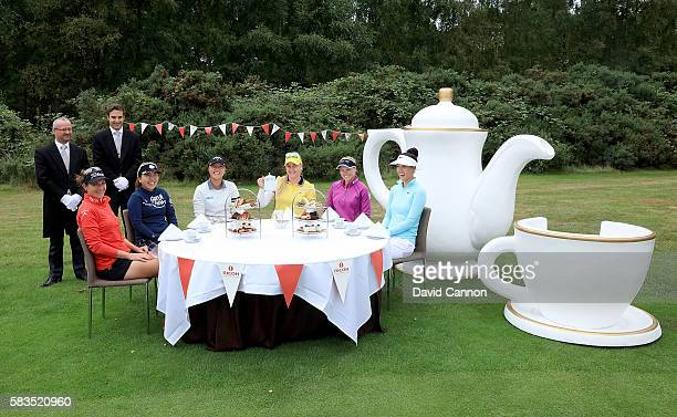 Charley Hull of England hosts a traditional English tea party for her fellow golfers at a photocall held at her home club Woburn GC Brittany Lang of...
