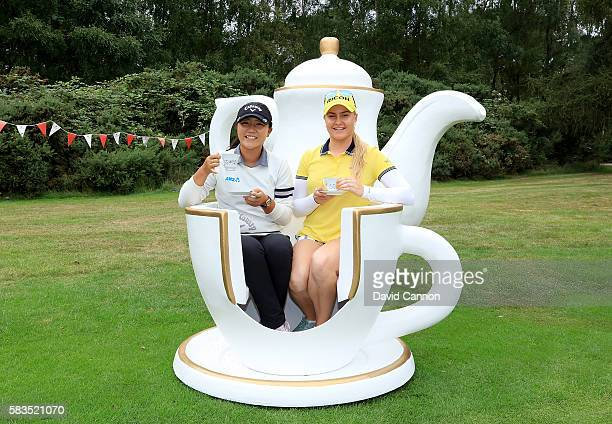 Charley Hull of England hosts a traditional English tea party for her fellow golfers at a photocall held at her home club Woburn GC Lydia Ko of New...