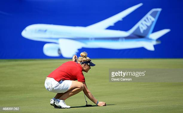 Charley Hull of England lines up a putt on the 18th green during the first round of the ANA Inspiration on the Dinah Shore Tournament Course at...