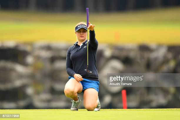 Charley Hull of England lines up her birdie putt on the 9th hole during the second round of the TOTO Japan Classics 2017 at the Taiheiyo Club Minori...