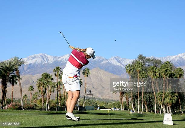 Charley Hull of England plays her tee shot at the par 3 14th hole during the first round of the 2014 Kraft Nabisco Championship on the Dinah Shore...