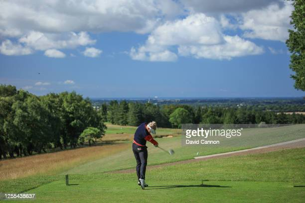 Charley Hull of England plays her tee shot on the seventh hole during the Clutch Pro Tour Major on The Downs Course at Goodwood Golf Club Golf Club...