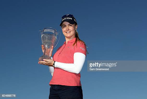 Charley Hull of England poses with the CME Tour Championship trophy during the final round of the CME Group Tour Championship at Tiburon Golf Club on...