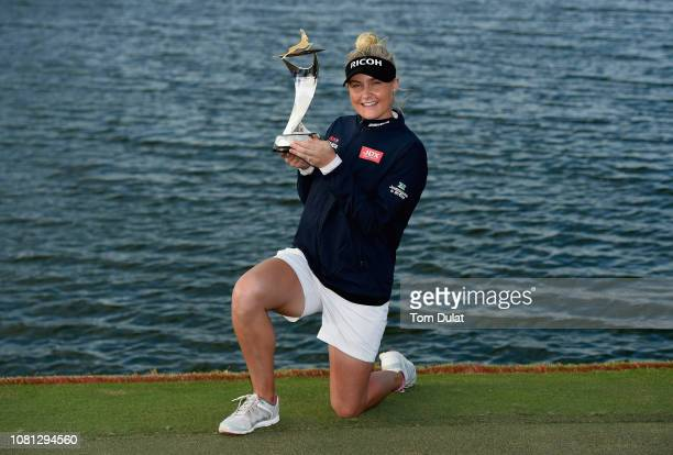 Charley Hull of England poses with the trophy after winning the Fatima Bint Mubarak Ladies Open at Saadiyat Beach Golf Club on January 12 2019 in Abu...