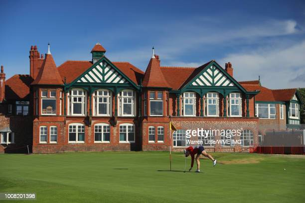 Charley Hull of England retrieves her ball on the 18th green during a pro-am round ahead of the Ricoh Women's British Open at Royal Lytham & St....