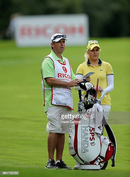 Charley Hull of England waits to play her second shot at the 13th hole with her caddie Adam Woodward during the third round of the 2016 Ricoh Women's...