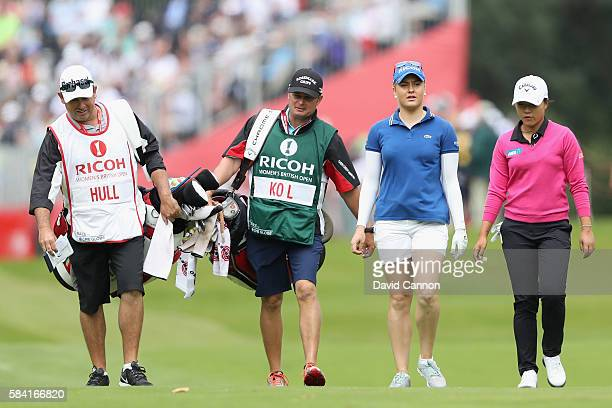 Charley Hull of England walks down the 1st hole with Lydia Ko of New Zealand during the first round of the 2016 Ricoh Women's British Open on July 28...