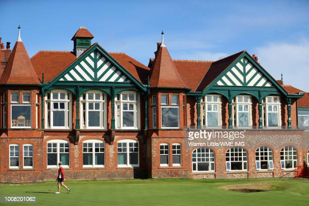 Charley Hull of England walks on the 18th green past the clubhouse during a pro-am round ahead of the Ricoh Women's British Open at Royal Lytham &...