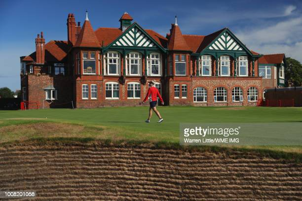 Charley Hull of England walks on the 18th green towards the clubhouse during a pro-am round ahead of the Ricoh Women's British Open at Royal Lytham &...