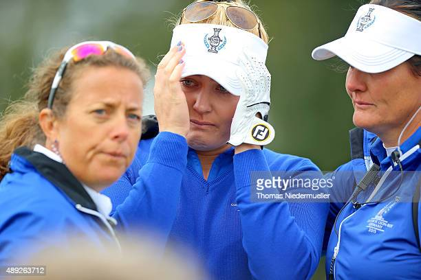 Charley Hull of the European Team in tears on the 18th green where she is being comforted by Fanny Sunesson and European Team vice captain Maria...