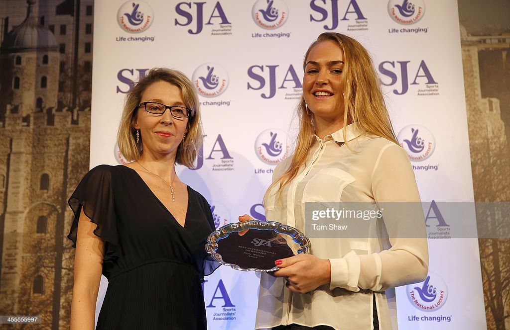 Charley Hull (R) receives the Peter Wilson trophy from Virginie Bernan of Laureus during the SJA British Sports Awards at Tower of London on December 12, 2013 in London, England.