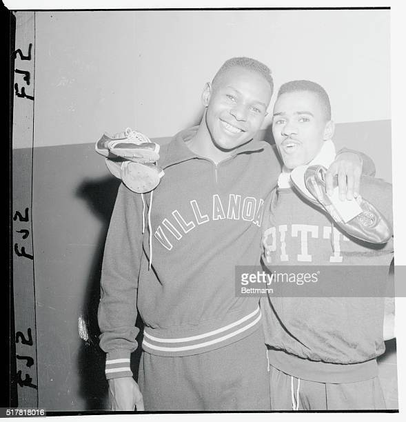 Charley Jenkins of Villanova and Arnie Sowell of Pittsburgh pose happily after winning their respective events at the NYAC Meeting in the Garden...