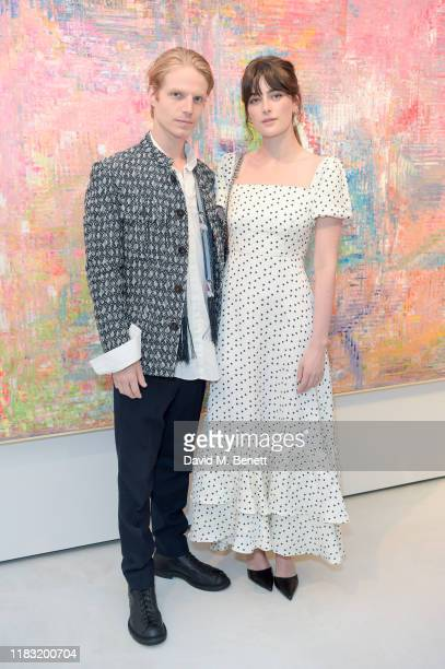 Charley Palmer Rothwell and Millie Brady attend a private view of EXTREMIS by Sassan BehnamBakhtiar on October 24 2019 in Dusseldorf Germany