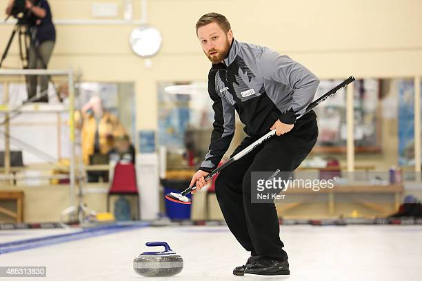 Charley Thomas of Canada watches his stone in the Curling Mixed Doubles Finals during the Winter Games NZ at Naseby Curling Rink on August 27 2015 in...
