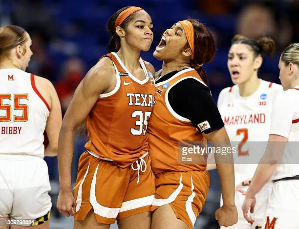 Charli Collier of the Texas Longhorns celebrates with teammate Lauren Ebo after Collier drew the foul in the fourth quarter against the Maryland...