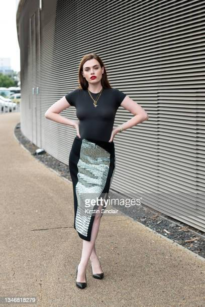 Charli Howard wears a Skims top, David Koma skirt, Christian Louboutin shoes, Harris Reed x Missoma necklaces during LFW September 2020 on September...