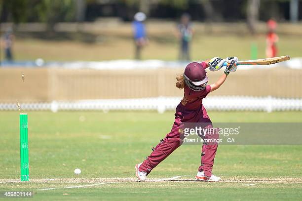 Charli Knott of Queensland is bowled out by Naomi Woods of NSW Metropolitan during the Under 15 female championship match between NSW Metro and QLD...