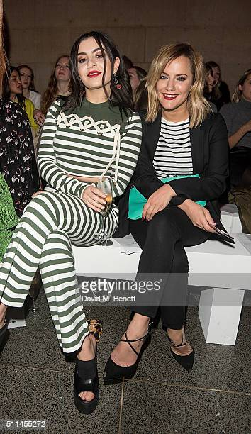 Charli XCX and Caroline Flack attend the House of Holland show during London Fashion Week Autumn/Winter 2016/17 at TopShop Show Space on February 20...