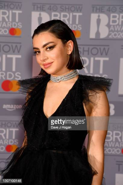 Charli XCX attends The BRIT Awards 2020 at The O2 Arena on February 18, 2020 in London, England.