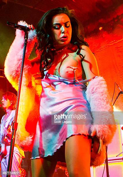 Charli XCX has wardrobe malfunction and exposes her breast as she performs at St Andrews Hall on October 11 2014 in Detroit Michigan
