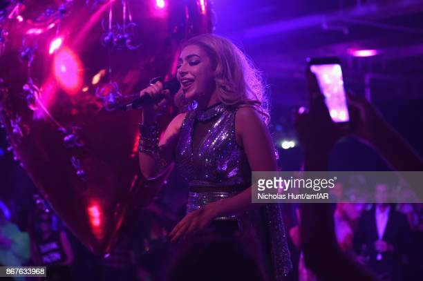 Charli XCX performs onstage during the 2017 amfAR The Naked Heart Foundation Fabulous Fund Fair at Skylight Clarkson Sq on October 28 2017 in New...