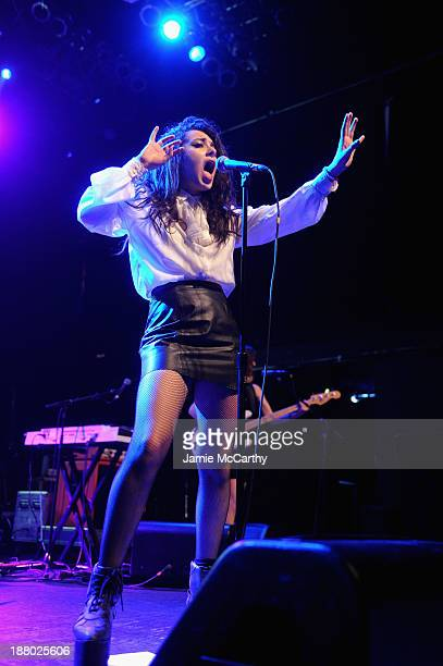 Charli XCX performs with Icona Pops onstage at the 19th Annual Out100 Awards presented by Buick at Terminal 5 on November 14 2013 in New York City