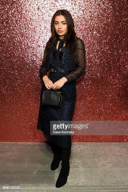 Charli XCX poses for a portrait during Coach Spring 2018 Fashion Show during New York Fashion Week at Basketball City Pier 36 South Street on...