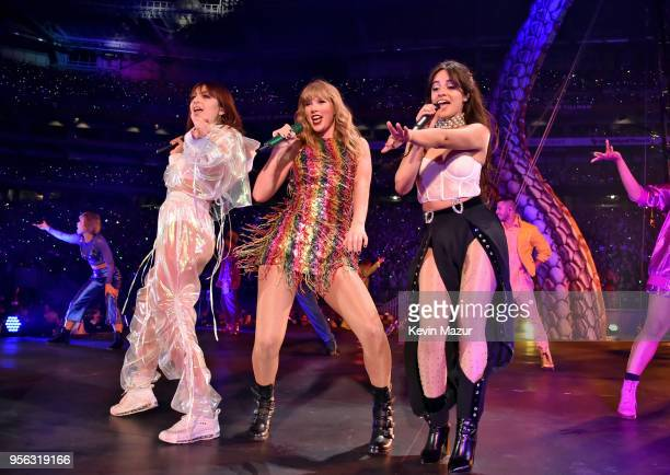 Charli XCX Taylor Swift and Camila Cabello perform onstage during opening night of Taylor Swift's 2018 Reputation Stadium Tour at University of...