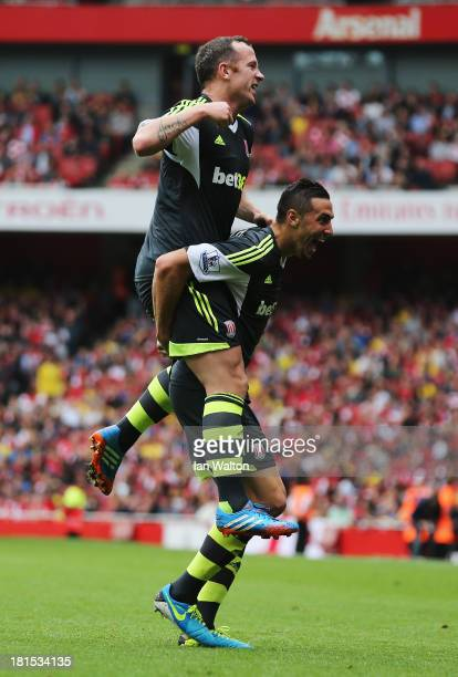 Charlie Adam celebrates on the shoulders of goalscorer Geoff Cameron of Stoke City during the Barclays Premier League match between Arsenal and Stoke...