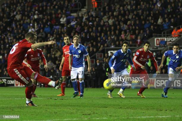Charlie Adam L of Liverpool fails to score from a penalty during the Barclays Premier League match between Wigan Athletic and Liverpool at the DW...