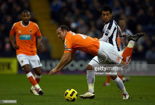 Charlie Adam of Blackpool is tackled by Gonzalo Jara of West Brom during the Barclays Premier League match between West Bromwich Albion and Blackpool...