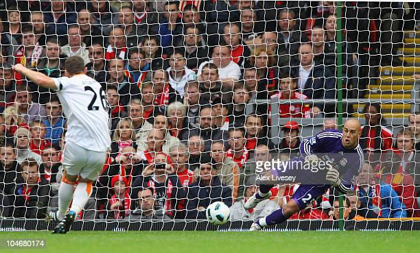 Charlie Adam of Blackpool scores the opening goal from the penalty spot during the Barclays Premier League match between Liverpool and Blackpool at...