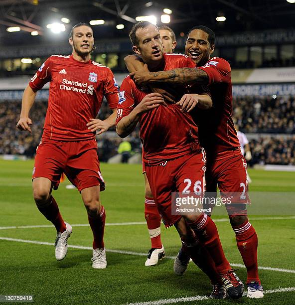 Charlie Adam of Liverpool celebrates after scoring the opening goal during the Barclays Premier League match between West Bromwich Albion and...