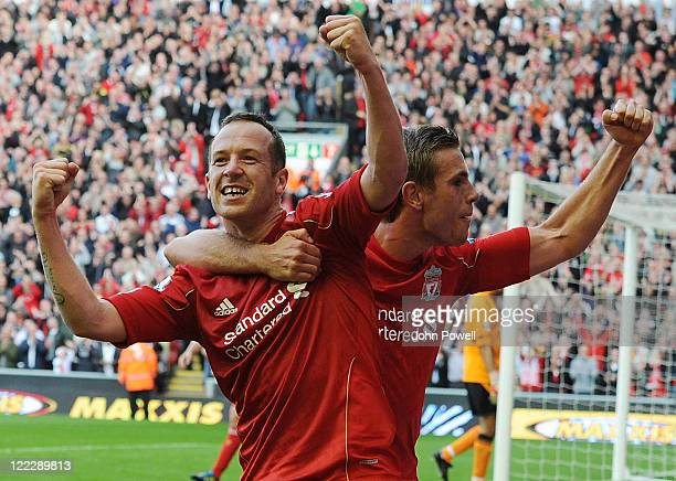 Charlie Adam of Liverpool celebrates his goal with teammate Jordan Henderson during the Barclays Premier League game between Liverpool and Bolton...