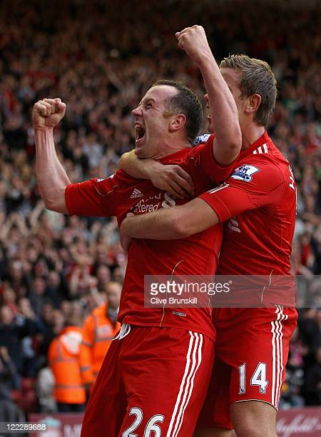 Charlie Adam of Liverpool celebrates scoring his side's third goal with team mate Jordan Henderson during the Barclays Premier League match between...