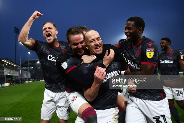 Charlie Adam of Reading celebrates with his teammates after scoring his sides second goal during the Sky Bet Championship match between Fulham and...