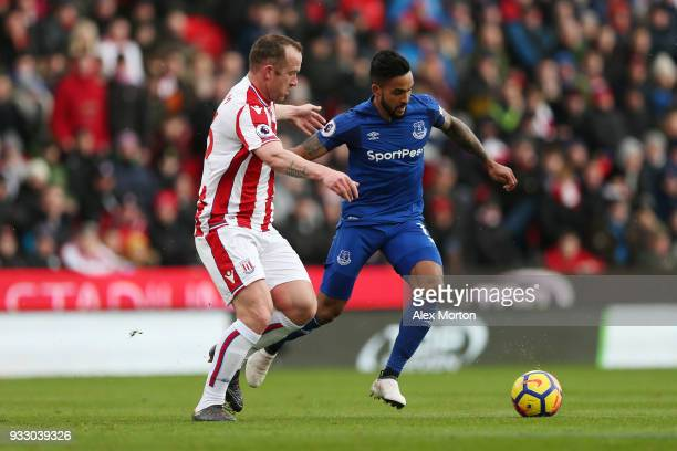 Charlie Adam of Stoke City and Theo Walcott of Everton battle for the ball during the Premier League match between Stoke City and Everton at Bet365...