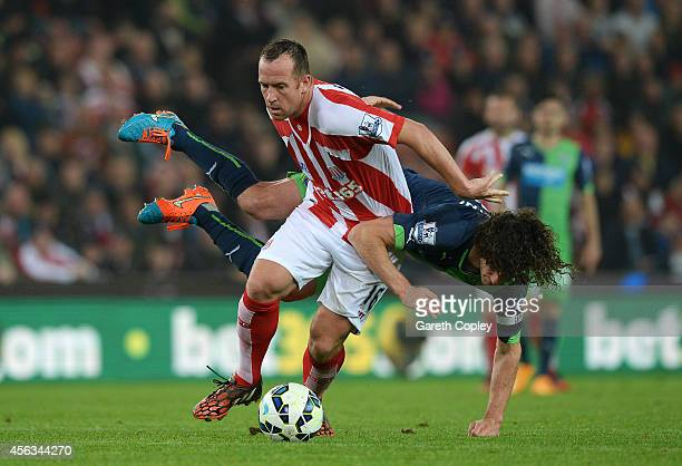 Charlie Adam of Stoke City battles for the ball with Fabricio Coloccini of Newcastle United during the Barclays Premier League match between Stoke...