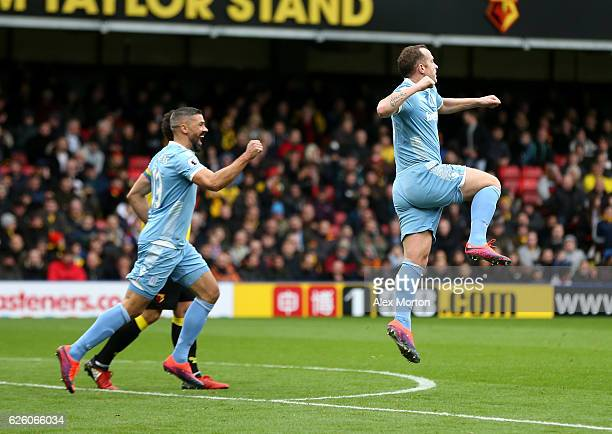 Charlie Adam of Stoke City celebrates his sides first goal after Heurelho Gomes of Watford scores an own goal during the Premier League match between...