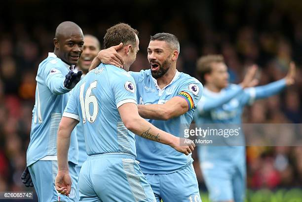Charlie Adam of Stoke City celebrates his sides first goal with Jonathan Walters of Stoke City after Heurelho Gomes of Watford scores an own goal...