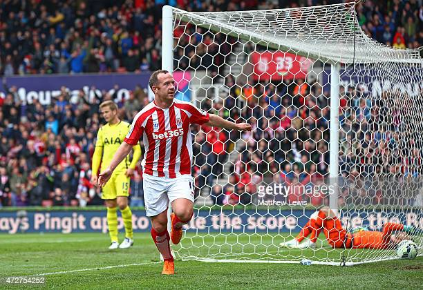 Charlie Adam of Stoke City celebrates scoring the opening goal during the Barclays Premier League match between Stoke City and Tottenham Hotspur at...