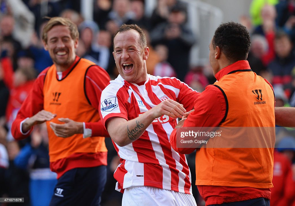 Charlie Adam of Stoke City (C) celebrates scoring their first goal with Peter Crouch and Peter Odemwingie of Stoke City during the Barclays Premier League match between Stoke City and Sunderland at Britannia Stadium on April 25, 2015 in Stoke on Trent, England.