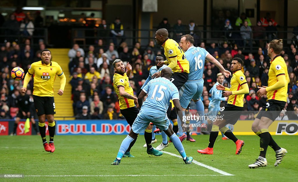 Charlie Adam of Stoke City (C) heads the ball towards goal which is defelected in via Heurelho Gomes of Watford (not pictured) for Stoke City first goal during the Premier League match between Watford and Stoke City at Vicarage Road on November 27, 2016 in Watford, England.