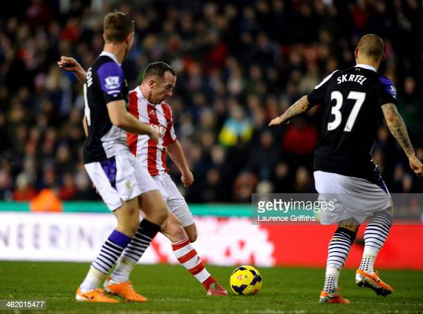 Charlie Adam of Stoke City shoots to score their second goal during the Barclays Premier League match between Stoke City and Liverpool at Britannia...