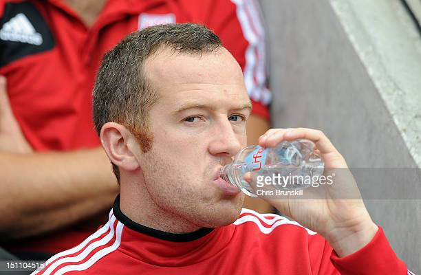 Charlie Adam of Stoke City takes a drink on the substitute's bench prior to the Barclays Premier League match between Wigan Athletic and Stoke City...