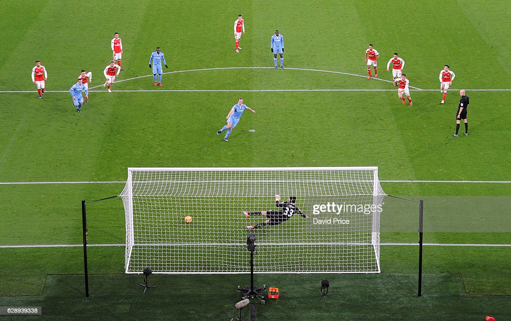 Charlie Adam scores Stokes goal during the Premier League match between Arsenal and Stoke City at Emirates Stadium on December 10, 2016 in London, England.